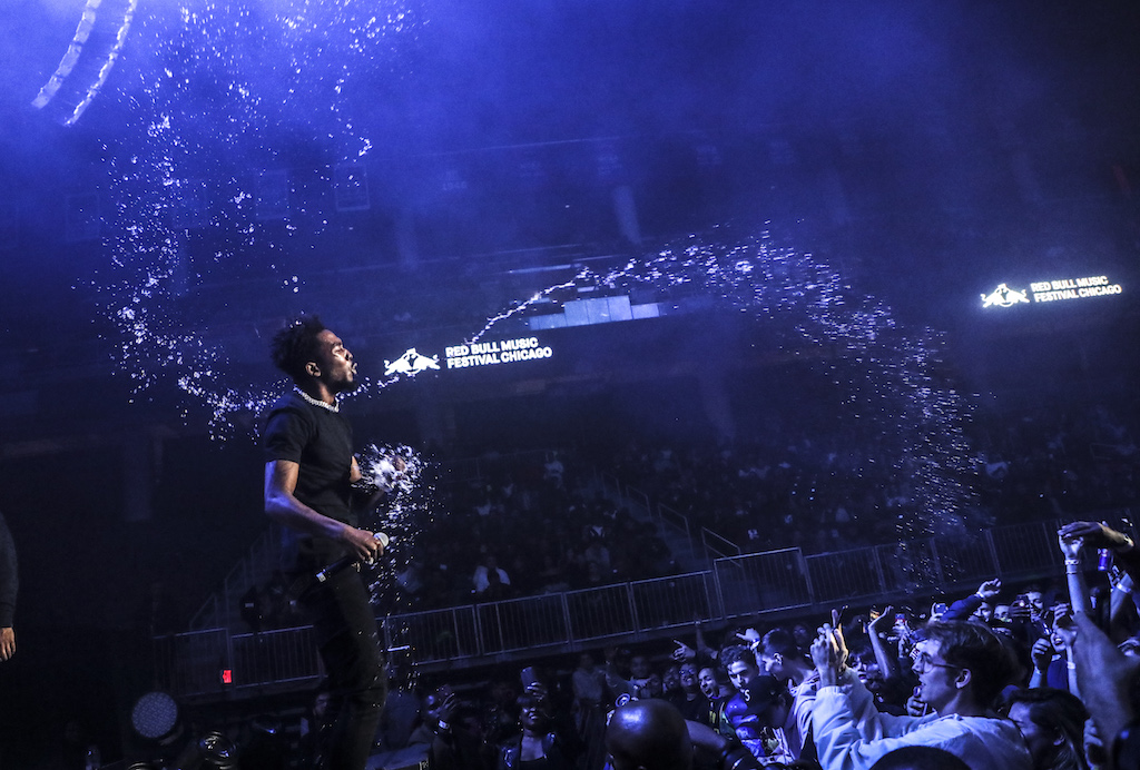 G.O.O.D. rapper Desiigner spraying the crowd during his set.
