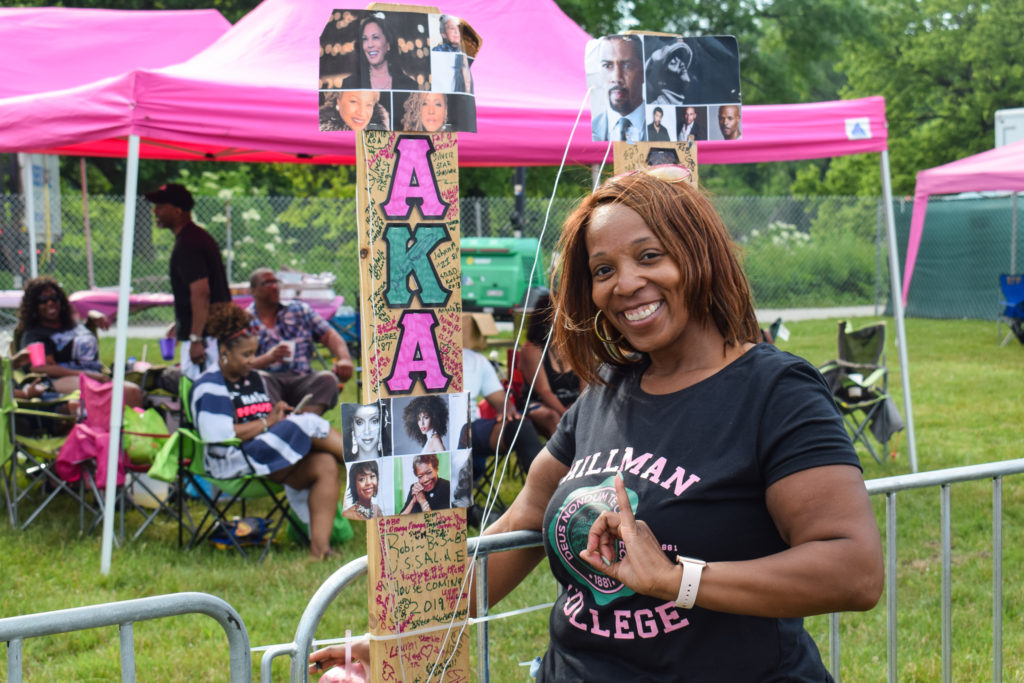 Joi Basley posing in front of her tent at the Chosen Few Picnic